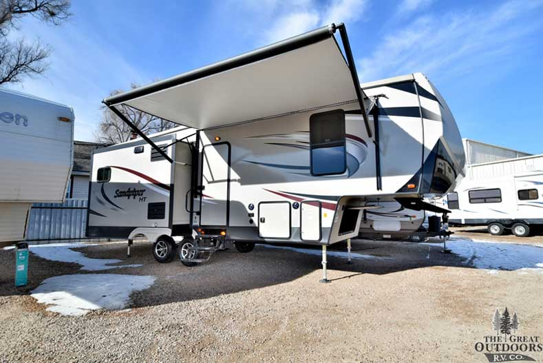 The Great Outdoors RV s120-2018-Forest-River-Sandpiper-3250IK Front passengers side awning