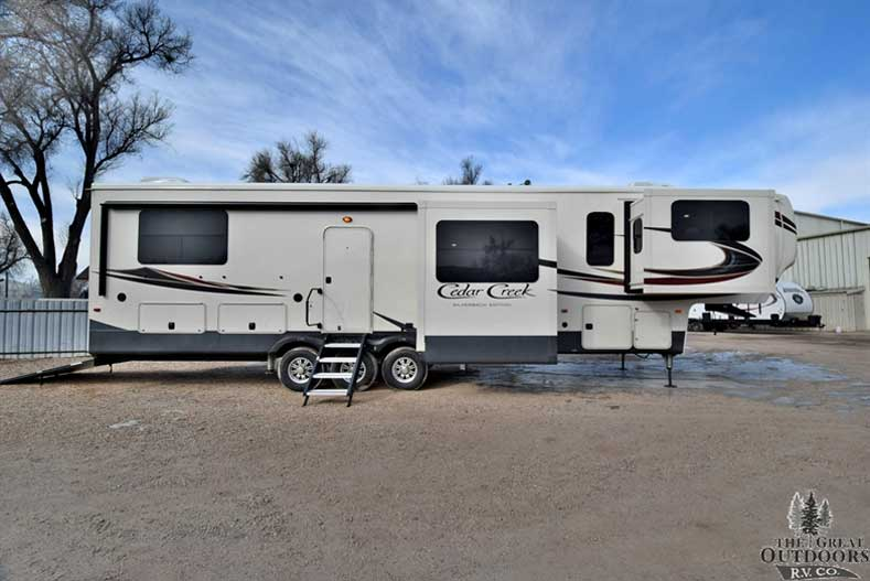The Great Outdoors RV CC297-2018-Forest-River-Cedar-Creek-Hathaway-Toy-Hauler-37RTH Passenger size exterior slides