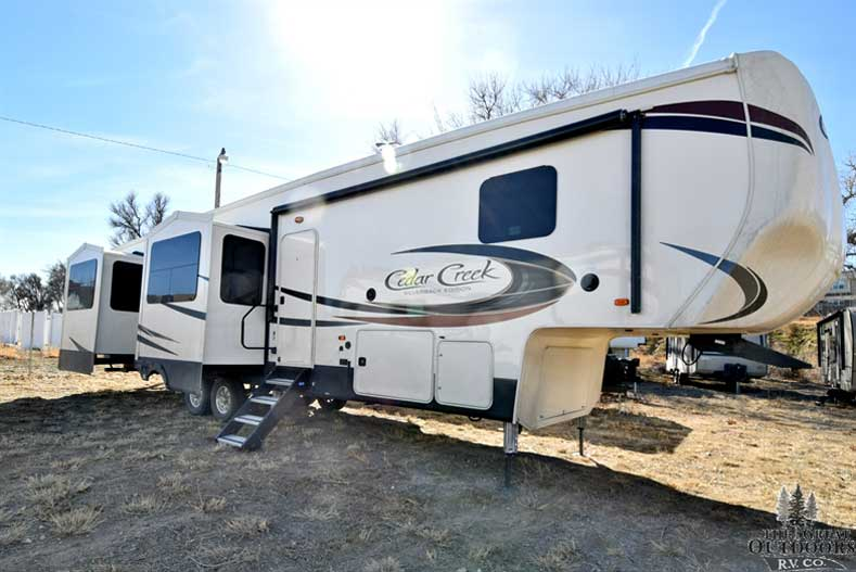 The Great Outdoors RV CC299 - 2018-Forest-River-Cedar-Creek-37RL Front passengers side exterior w/slides out